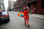 BROOKLYN -- APRIL 16, 2011: Jessi Arrington walks down the street with a rainbow and a ladder on her way to Studiomates on April 16, 2011 in Dumbo, Brooklyn.   (PHOTOGRAPH BY MICHAEL NAGLE)
