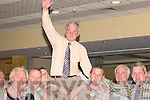 Pat McCarthy Fine Gaeil, who was elected to the County Council on Sunday hoisted to the air by his supporters..