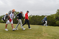 Austin Cook (USA), Martin Kaymer (GER), and Cody Gribble (USA) head down 15 during Round 2 of the Valero Texas Open, AT&amp;T Oaks Course, TPC San Antonio, San Antonio, Texas, USA. 4/20/2018.<br /> Picture: Golffile | Ken Murray<br /> <br /> <br /> All photo usage must carry mandatory copyright credit (&copy; Golffile | Ken Murray)