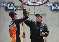 Aug. 7, 2011; Kent, WA, USA; NHRA top fuel dragster driver Scott Palmer (right) gets a high-five from Spencer Massey during the Northwest Nationals at Pacific Raceways. Mandatory Credit: Mark J. Rebilas-