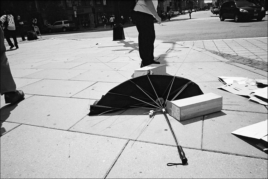 The delicate balance of atanding and walking<br /> From &quot;Walking Downtown&quot; series. Washington, D.C., 2009