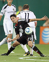Pablo Hernandez #21 of D.C. United gets the ball away from Chris Birchall #11 of the Los Angeles Galaxy during an MLS match at RFK Stadium on July 18 2010, in Washington D.C. Galaxy won 2-1.