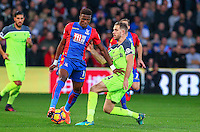 Jordan Henderson of Liverpool and Wilfried Zaha of Crystal Palace compete for the ball during the EPL - Premier League match between Crystal Palace and Liverpool at Selhurst Park, London, England on 29 October 2016. Photo by Steve McCarthy.
