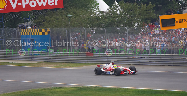 MONTREAL - JUNE 12: Ralf Schumacher of Panasonic Toyota Racing zooms past the general admission crowd during the  Canadian F1 Grand Prix at the Circuit Gilles-Villeneuve June 12, 2005 in Montreal, Canada.