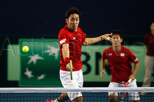 05.03.2016. Barclaycard Arena, Birmingham, England. Davis Cup Tennis World Group First Round. Great Britain versus Japan. Yasutaka Uchiyama of Japan hits a backhand volley during the doubles match between Great Britain's Andy Murray and Jamie Murray and Japan's Yoshihito Nishioka and Yasutaka Uchiyama on day 2 of the tie. GB won in straight sets 6-3, 6-2, 6-4.