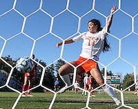 Virginia's Morgan Ruether (18) nudges the ball into the net during the first round of the ACC Tournament against Maryland Sunday at Klockner Stadium.  Virginia defeated Maryland 6-1. Photo/The Daily Progress/Andrew Shurtleff