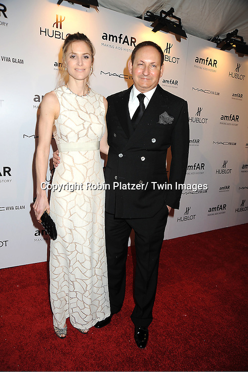 John Demsey and guest arrive at the amfAR New York Gala to kcik off Fashion Week on February 8, 2012 at Cipriani Wall Street in New York City.