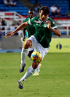 CALI -COLOMBIA-05-10-2014. Sergio Herrera jugador del Deportivo Cali en acción durante partido con Uniautónoma por la fecha 13 de la Liga Postobón II 2014 jugado en el estadio Pascual Guerrero de la ciudad de Cali./ Deportivo Cali player Sergio Herrera in action during match against Uniautonoma for the 13th date of Postobon League II 2014 played at Pascual Guerrero stadium in  Cali city.Photo: VizzorImage/ Juan C. Quintero /STR