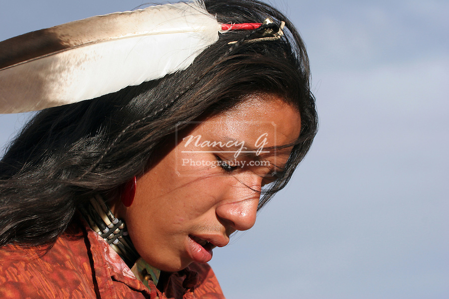 A Native American Indian in South Dakota with a eagle feather in his hair