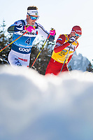 1st January 2020, Toblach, South Tyrol , Italy;  Calle Halfvarsson of Sweden and Sergey Ustiugov of Russia compete in the mens 15 km classic technique pursuit during Tour de Ski on January 1, 2020 in Toblach.