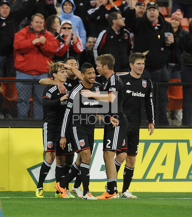Washington D.C. - April 5, 2014:  Chris Rolfe (18) of D.C. United celebrates his score with teammates in the 90+ minute of the game. D.C. United defeated 2-0 the New England Revolution during a Major League Soccer match for the 2014 season at RFK Stadium.