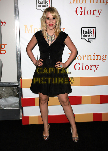 "NATASHA BEDINGFIELD.The World Premiere of ""Morning Glory"" at the Ziegfeld Theater, New York, NY, USA. .November 7th, 2010.full length black dress bending leaning hands on hips silver shoes necklace .CAP/ADM/PZ.©Paul Zimmerman/AdMedia/Capital Pictures."