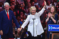 Brooklyn, NY - June 7, 2016: Democratic presidential candidate Hillary Clinton waves to supporters as she is joined by former president Bill Clinton and their daughter Chelsea during a rally in Brooklyn, NY, June 7, 2016. Clinton spoke to the audience after winning enough delegates to clinch her party's nomination, becoming the first female in history to do so.   (Photo by Don Baxter/Media Images International)