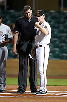 Salt River Rafters manager Matt Williams #9, of the Arizona Diamondbacks organization, talks with umpire Jordan Baker before an Arizona Fall League game against the Mesa Solar Sox at Salt River Fields at Talking Stick on October 9, 2012 in Scottsdale, Arizona.  Salt River defeated Mesa 6-5.  (Mike Janes/Four Seam Images)