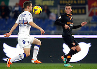 Calcio, ottavi di finale di Coppa Italia Tim: Roma vs Sampdoria. Roma, stadio Olimpico, 9 gennaio 2014.<br /> Sampdoria defender Michele Fornasier, left, and AS Roma forward Adem Ljajic, of Serbia, fight for the ball during the Italy Cup round of sixteen football match between AS Roma and Sampdoria at Rome's Olympic stadium, 9 January 2014.<br /> UPDATE IMAGES PRESS/Isabella Bonotto
