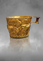 Vapheio type Mycenaean gold cup depicting a wild bull hunt , Vapheio Tholos Tomb, Lakonia, Greece. National Archaeological Museum of Athens.   Grey Art Background<br /> <br />  Two masterpieces of Creto - Mycenaean gold metalwork were excavated from a tholos tomb near Lakonia in Sparta in 1988. Made in the 15th century BC, the gold cups are heavily influenced by the Minoan style that was predominant in the Agean at the time. The bull hunt was popular with  Mycenaean  and Minoan artists and symolised power and fertility. The distinctive shape of the cup is kown as 'Vapheio type'.