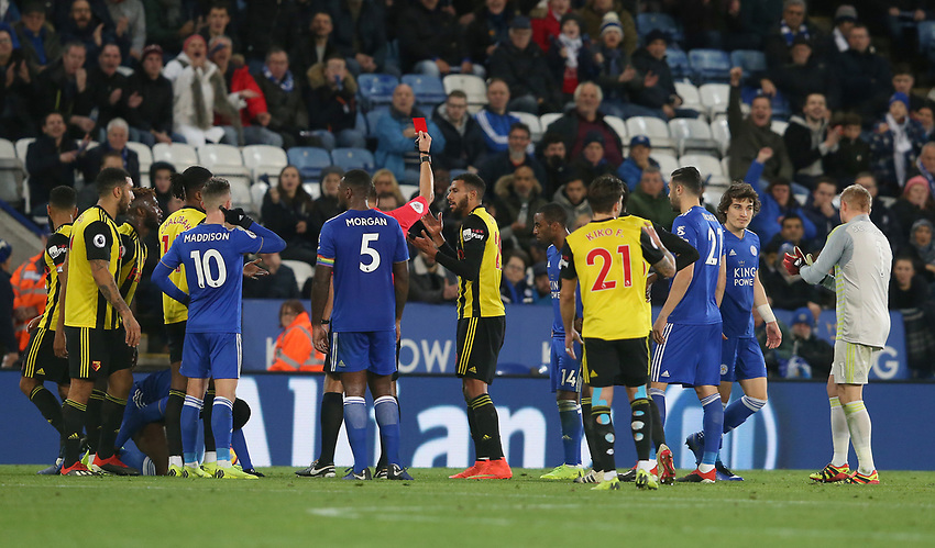 Referee Graham Scott shows a straight red card to Watford's Etienne Capoue for his challenge on Leicester City's Kelechi Iheanacho <br /> <br /> <br /> <br /> Photographer Stephen White/CameraSport<br /> <br /> The Premier League - Leicester City v Watford - Saturday 1st December 2018 - King Power Stadium - Leicester<br /> <br /> World Copyright © 2018 CameraSport. All rights reserved. 43 Linden Ave. Countesthorpe. Leicester. England. LE8 5PG - Tel: +44 (0) 116 277 4147 - admin@camerasport.com - www.camerasport.com