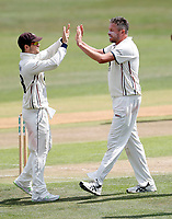 Mitch Claydon (R) of Kent enjoys a high five with Sean Dickson after taking the wicket of Callum Parkinson during the County Championship Division 2 game between Kent and Leicestershire (Day 2) at the St Lawrence ground, Canterbury, on Mon July 23, 2018