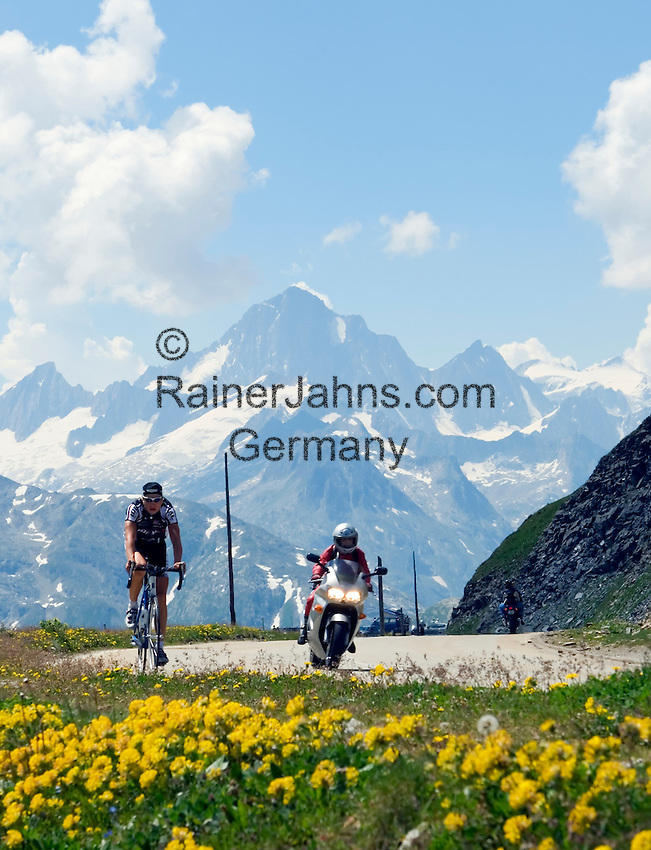 Switzerland, Canton Valais, cyclist and biker at Furka Pass, border between cantones Valais and Uri. Finsteraarhorn mountain (4.274 m) in the Background