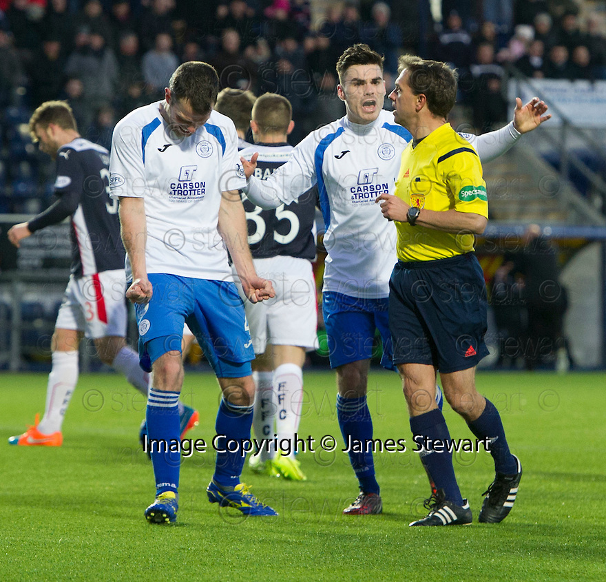 Queen of the South's Andy Dowie and Queen of the South's Ian McShane complain to Referee Crawford Allan after he gave Falkirk a second penalty.
