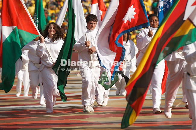 JOHANNESBURG - JUNE 11:  Children carry country flags as part of the opening ceremony of the 2010 FIFA World Cup soccer tournament June 11, 2010 at Soccer City Stadium in Johannesburg, South Africa.  Editorial use only.  (Photograph by Jonathan P. Larsen)