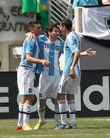 Argentina forward  Lionel Messi (10) celebrates first of his three goal effort with teammates. In an international friendly (Clash of Titans), Argentina defeated Brazil, 4-3, at MetLife Stadium on June 9, 2012.