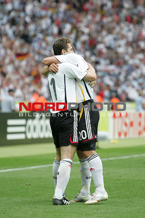 FIFA WM 2006 - Quarter-finals / Viertelfinale<br /> Play #57 (30-Jun) - Germany vs Argentina.<br /> Miroslav Klose and Lukas Podolski (l-r) from Germany celebrate the 1-1 during the match of the World Cup in Berlin.<br /> Foto &copy; nordphoto