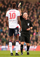 Bolton Wanderers' Sammy Ameobi is is shown a yellow card by Scott Duncan<br /> <br /> Photographer David Shipman/CameraSport<br /> <br /> The EFL Sky Bet Championship - Norwich City v Bolton Wanderers - Saturday 8th December 2018 - Carrow Road - Norwich<br /> <br /> World Copyright &copy; 2018 CameraSport. All rights reserved. 43 Linden Ave. Countesthorpe. Leicester. England. LE8 5PG - Tel: +44 (0) 116 277 4147 - admin@camerasport.com - www.camerasport.com