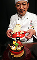 "October 12, 2017, Tokyo, Japan - Japan's Prince Hotels executive chef pastry and bakery Takeshi Naito displays a Santa Claus shaped Christmas cake ""Santa Claus"" priced 16,000 yen at a press preview for the hotel chain's Christmas cake collection at the Prince Park Tower hotel  in Tokyo on Thursday, Octoebr 12, 2017. The hotel chain started to accept orders and will deliver before Christmas Day.   (Photo by Yoshio Tsunoda/AFLO) LWX -ytd-"