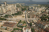 Rio de Janeiro, Brazil. aerial view of Praça Cardeal Câmara and the Arcos da Lapa viaduct with Guanabara Bay looking south west.