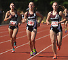 North Shore runners, from right, Stacie Nadel, Diana Vizza and Stephanie Bazan stay ahead of the competition in the girls' 1,500 meter run during the Nassau County Class A varsity track and field championships at Roosevelt High School on Friday, May 29, 2015. Nadel, Vizza and Bazan took the top three spots in the event by finishing first, second and third respectively.<br /> <br /> James Escher
