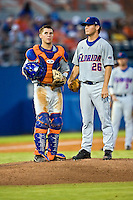 June 07, 2009:  NCAA Super Regional: Southern Miss Golden Eagles vs Florida Gators:   Florida catcher Buddy Monroe (4) talks with his pitcher Nick Maronde (26) during game two of Super Regional action at Alfred A. McKethan Stadium on the campus of University of Florida in Gainesville.  Southern Miss came from behind to defeat Florida 7-6 and to advance to the College World Series.   ...........