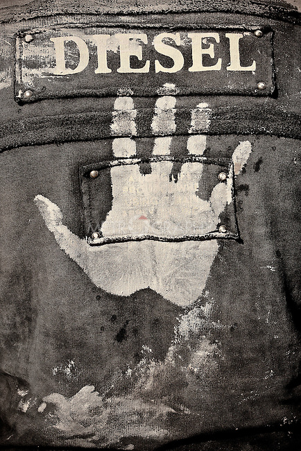 KHORRAMABAD, IRAN : A muddy handprint on a mourner's jacket during the festival of Ashura...Every year to mark the death of Imam Hussein, Shia Muslims mourn for two days. In Khorramabad and Lorestan in the west of Iran, during the first day of mourning, called Tasooa, women take a vow of silence and go through the streets with the children lighting candles. At 4 am on Ashura, the second day, men cover themselves in mud and then stand in front of a fire until the mud has dried to clay. After this they go to the mosque and pray...Photo by Farhad Babaei/Metrography