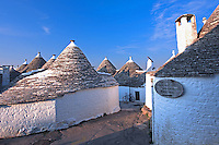 A winding street through the trulli-style homes of  Alberobello, Italy.