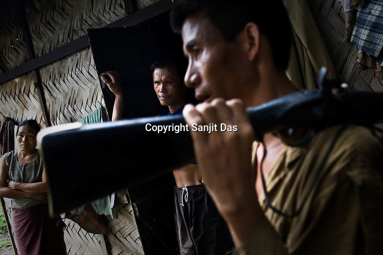 43 year old Damtuing (right) is seen with other refugees from the Mabauram village. Suspected Dimasa group killed 2 youths (aged 16 and 14) and burnt 21 houses out of 25 in village Mabauram in the outskirts of Haflong, Assam, India. Ethnic clashes are regularly taking place between Zeme Nagas and the Dimasa tribe in North Cachar Hills.