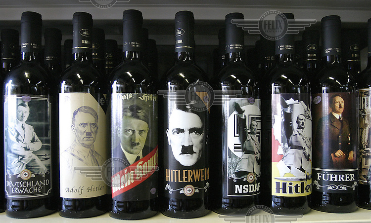 Bottles of Hitler wine on the shelves of a petrol station in southern Austria. The bottles carry inscriptions like 'Deutschland Erwache' (Germany Awake), 'Mein Kampf' (My Struggle), 'NSDAP' (abbreviation for National Socialist Party of Germany) and 'Fuhrer' (leader). .