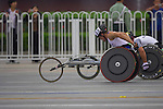 Great Britain's Brian Alldis pushes hard across the Tianamen square road at the 3km mark in the marathon.