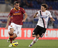 Calcio, Serie A: Roma vs Palermo. Roma, stadio Olimpico, 4 novembre 2012..AS Roma forward Pablo Daniel Osvaldo is challenged by Palermo midfielder Edgar Osvaldo Barreto, of Paraguay, right, during the Italian Serie A football match between AS Roma and Palermo, at Rome's Olympic stadium, 4 november 2012..UPDATE IMAGES PRESS/Riccardo De Luca