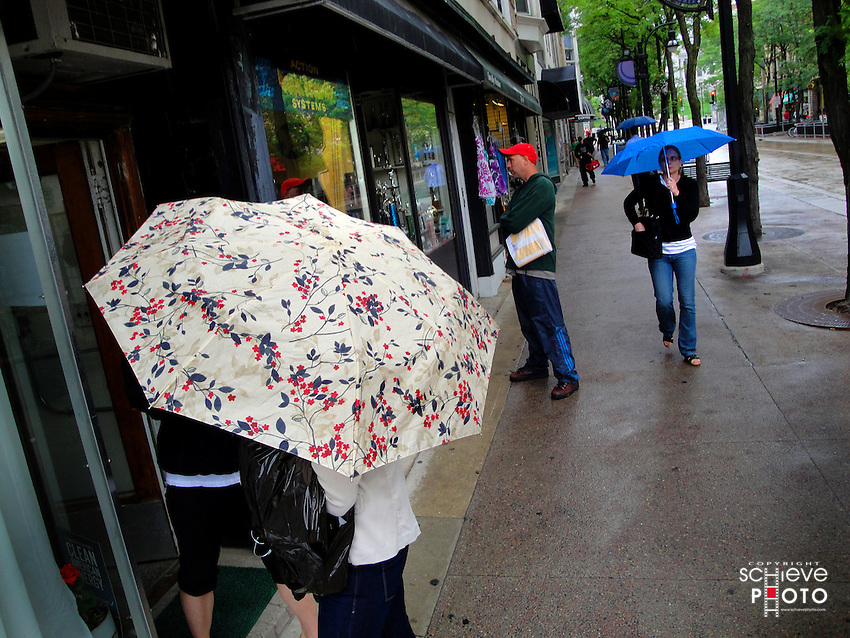 People enjoying the rainy weather in downtown Madison, Wisconsin.