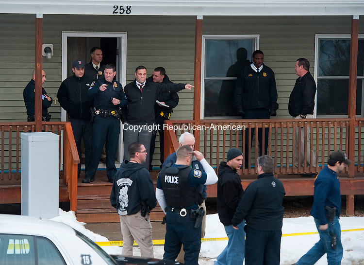 WATERBURY, CT-121913JS01- Waterbury police investigate two bodies found inside an apartment at 258 Cooke Street in Waterbury on Thursday afternoon.<br /> Jim Shannon Republican-American