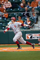 Oklahoma Sooners first basman Matt Oberste #14 follows through on his swing against the Texas Longhorns in the NCAA baseball game on April 5, 2013 at UFCU DischFalk Field in Austin Texas. Oklahoma defeated Texas 2-1. (Andrew Woolley/Four Seam Images).