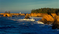 972500003 a panoramic image of sunset light on the cape arago lighthouse and the coastal seamounts along the central pacific coast of oregon