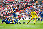 Alex Iwobi of Arsenal has a shot saved by Thibaut Courtois (GK) of Chelsea, under pressure from Marcos Alonso of Chelsea during the The FA Community Shield match at Wembley Stadium, London. Picture date 6th August 2017. Picture credit should read: Charlie Forgham-Bailey/Sportimage