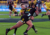 Jordie Barrett tackles Sean Wainui during the Super Rugby match between the Hurricanes and Chiefs at Westpac Stadium in Wellington, New Zealand on Friday, 13 April 2018. Photo: Dave Lintott / lintottphoto.co.nz