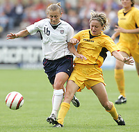 10 July 2005:  Tiffeny Milbrett of USA fights for the ball against Ukraine defender at Merlo Field at University of Portland in Portland, Oregon.    USA defeated Ukraine, 7-0.   Credit: Michael Pimentel / ISI