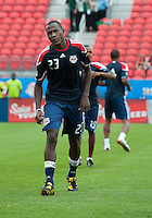 August 21 2010 New York Red Bulls midfielder Tony Tchani #23 warms up during a game between the New York Red Bulls and Toronto FC at BMO Field in Toronto..The New York Red Bulls won 4-1.