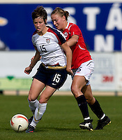 USWNT forward (15) Megan Rapinoe makes her way past Norwegian defender (15) Hedda Strand Gardsjord during the last group stage game in the Algarve Cup.  The USWNT defeated Norway, 1-0, in Ferreiras, Portugal. Photo by Brad Smith/ isiphotos.com