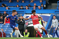 Xavier Amaechi of Arsenal in action as Chelsea's George McEachran looks on during Chelsea Under-23 vs Arsenal Under-23, Premier League 2 Football at Stamford Bridge on 15th April 2019