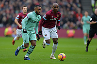 Alexandre Lacazetten of Arsenal and Angelo Ogbonna during West Ham United vs Arsenal, Premier League Football at The London Stadium on 12th January 2019