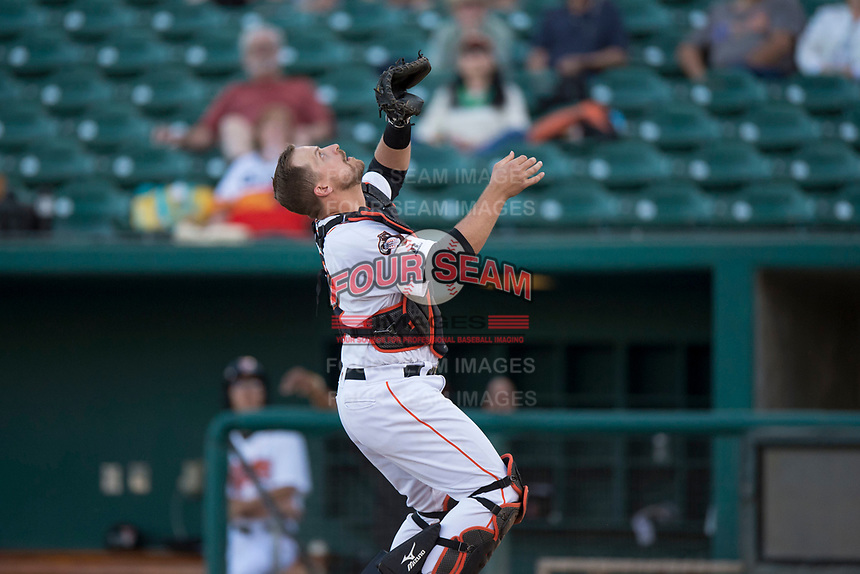 Fresno Grizzlies catcher Tim Federowicz (26) settles under a pop fly in foul territory during a Pacific Coast League game against the Salt Lake Bees at Chukchansi Park on May 14, 2018 in Fresno, California. Fresno defeated Salt Lake 4-3. (Zachary Lucy/Four Seam Images)